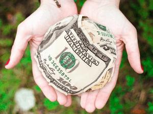 Holding money in hands.