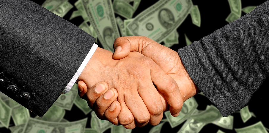 Shaking hands after making 2000 dollars.