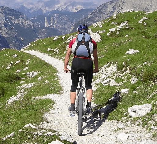 Riding a financed mountain bike.