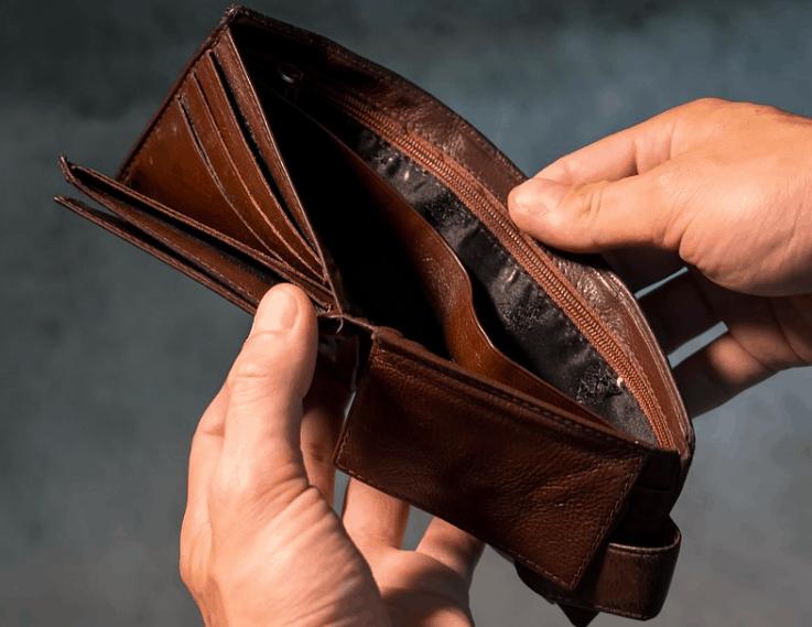 Looking into an empty wallet needing a loan.