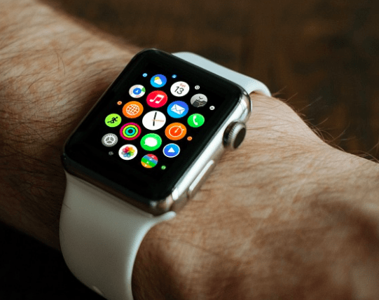 An Apple watch being worn.