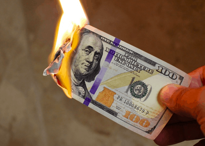 Wasting or burning your money.