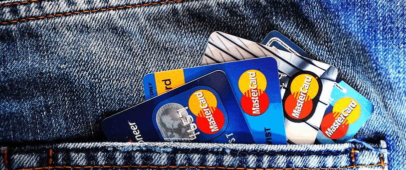 Credit cards in a pocket of a pair of jeans.