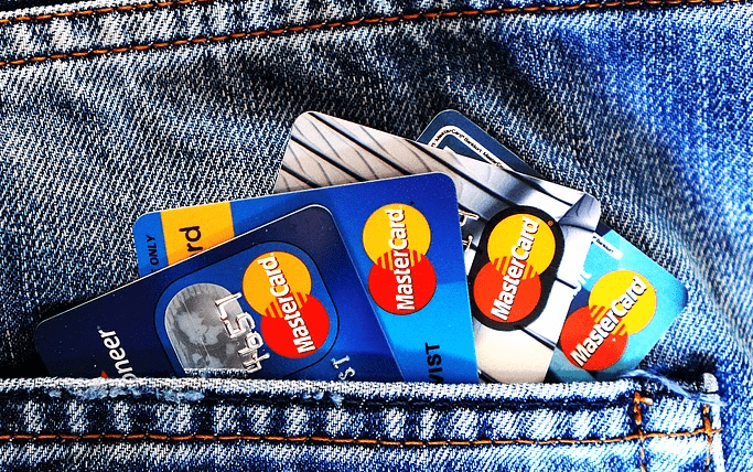 a lot of credit cards in a pocket.