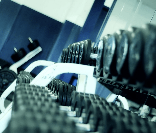 A weight rack at a discount gym.