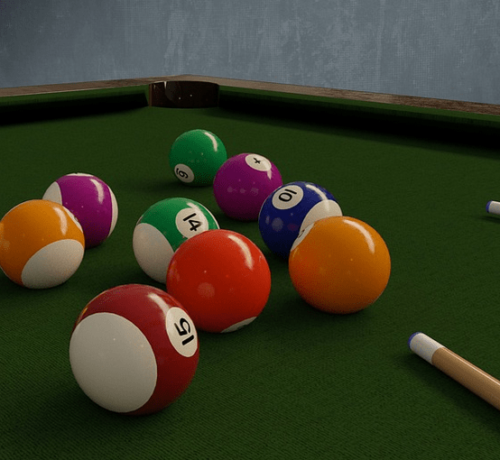 Playing on a pool table.