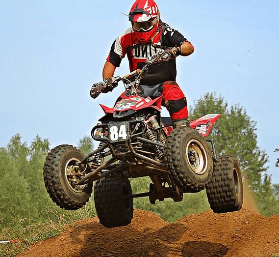 A man riding an ATV