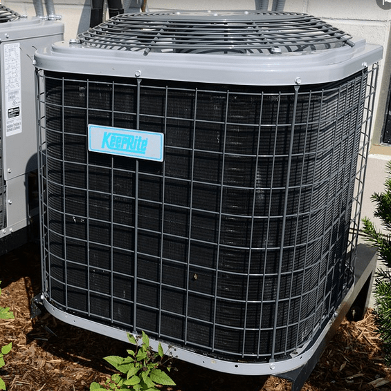 An HVAC system on the side of a home.