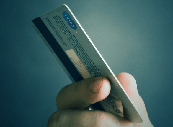 Holding a store credit card.