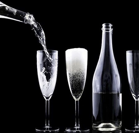 Pouring champagne for a new year.