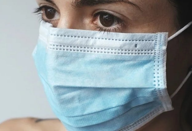A woman wearing a mask during a pandemic