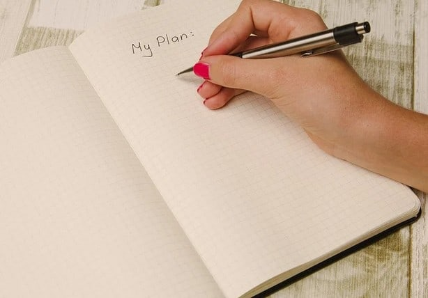 A woman doing meal planning.