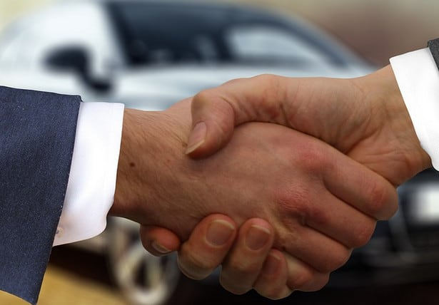 Shaking hands after an auto loan