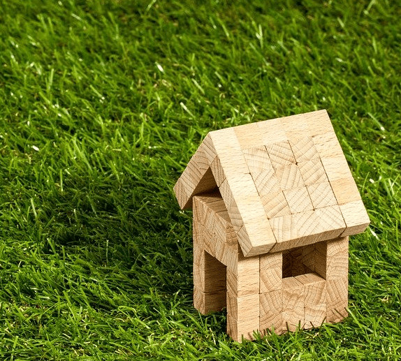 A toy house on the grass.