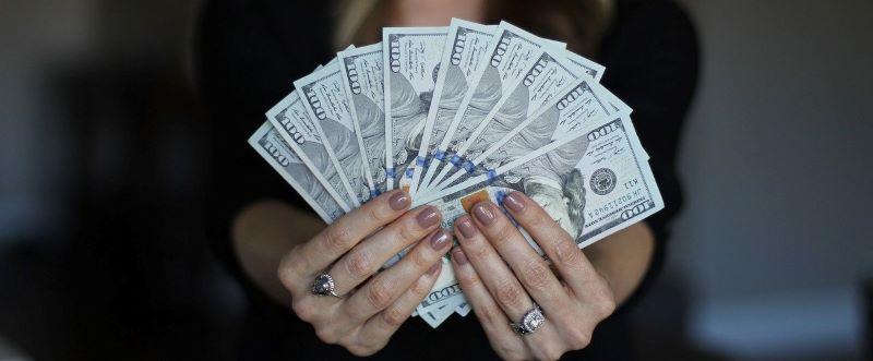Hundred dollar bills from a $2800 loan.