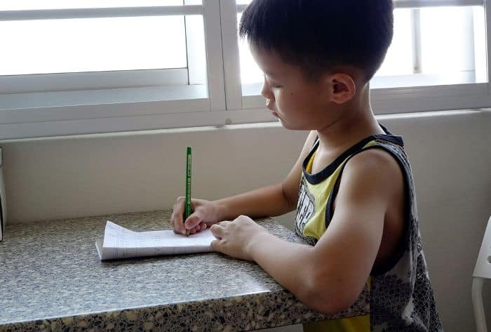 A child writing a budget.