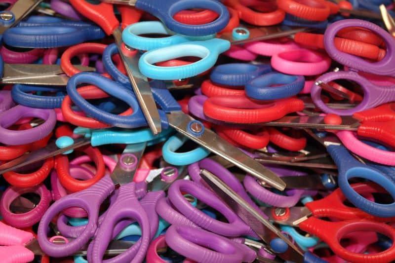 Cutting expesnes wih scissors.
