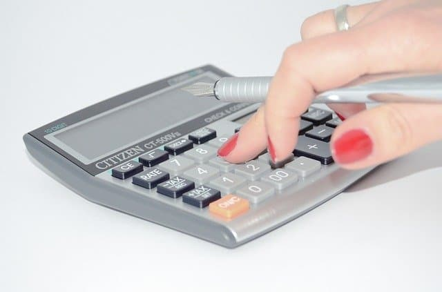 A calculator being used to slash household expenses.