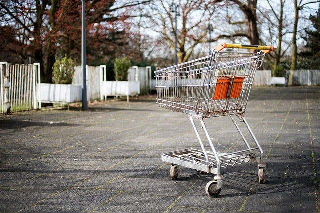 A shopping cart empty of groceries.