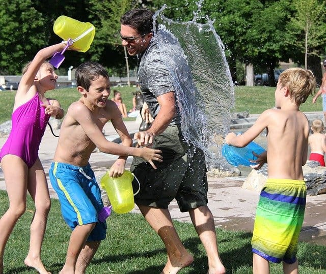 A water fight in the middle of summer.