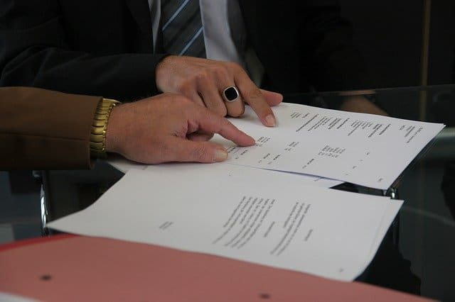 Going over a loan contract.