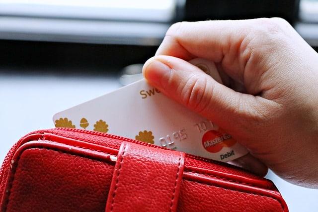 A woman deciding she needs a credit card